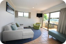 Spacious 2 bedroom serviced holiday apartments, kitchen facilities, private deck and spa pool